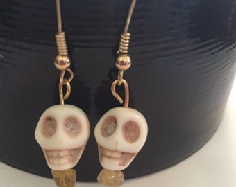 Skull with crystal earrings