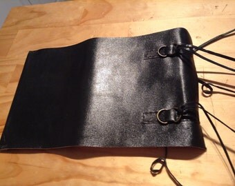Up cycled leather journal .