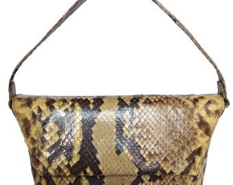 A vintage snakeskin handbag