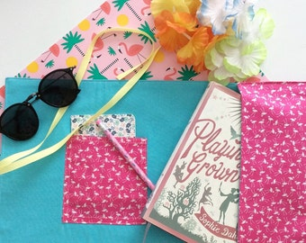 Book sleeve with flamingo print
