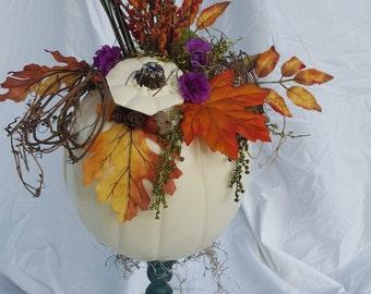 White pumpkin on stand