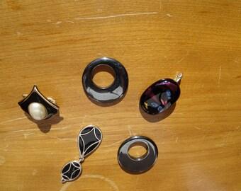 Black pendant lot #1.Hematite, enamel, mixed media pendant lot