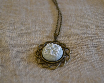 Hand embroidered button necklace