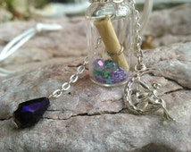 Clear glass wish bottle. With silver fairy charm and wish scroll.