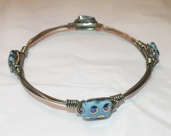 Wire Wrapped Bangle With Blue Spotted Glass Bead