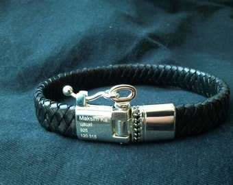 Silver and leather bracelet.
