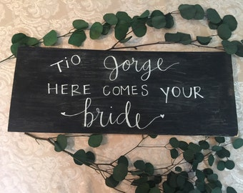 Tio, here comes your bride/Here comes your Bride sign.