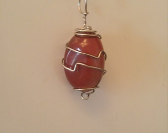 Goldstone silver wire wrapped pendant.