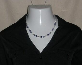 "Purple glass pearl 'Ball and Chain'; ""Daisy"""