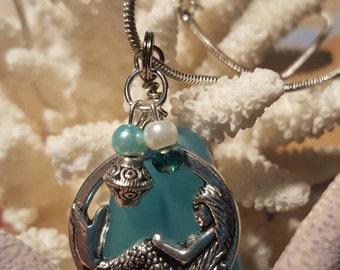 "Mermaid on aqua-colored sea glass pendant. 18"" snake chain"