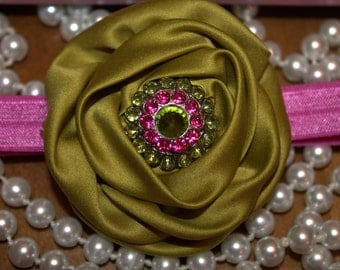 green and pink headband with satin flower