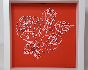 Roses in red papercut or been kirigami hand against a plain background