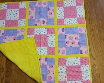 Pink, purple, yellow and white Baby Quilt