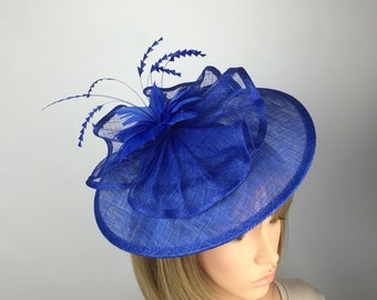 Last 1! Royal fascinator on aliceband. Blue hatinator with flower and feather detail for ascot ladies day wedding bride