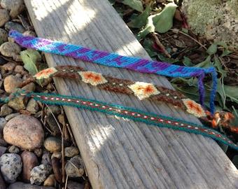 Set of three woven bracelets