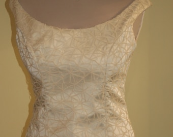 Wedding dress with lace trimmed corselet in cream, A-line
