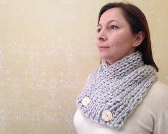 silvery gray scarf with two wooden buttons