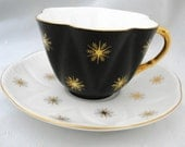 Shelley black dainty gold star snow flakes teacup and saucer