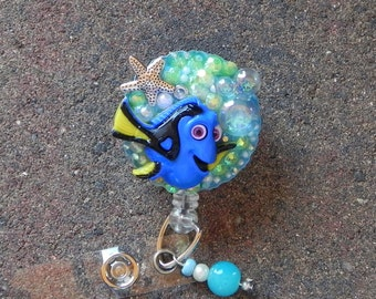 Anchor arrows badge holder anchor blue retractable by for Blue fish pediatrics