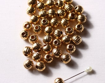 44 ball 10mm gold, round, glossy and textured (7233)