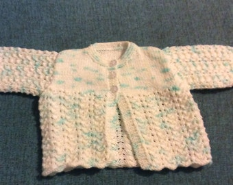 Knitted cardigan for a baby