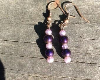 Purple pearl dangle earrings.