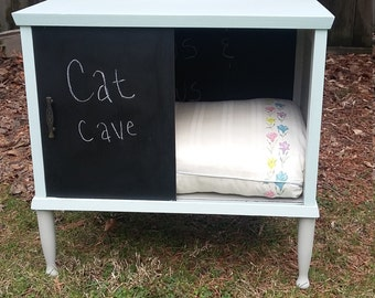 Antique record cabinet upcycled into a pet bed