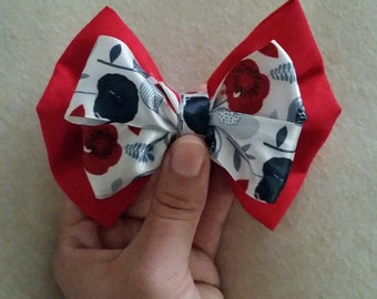 red bow with floral accent