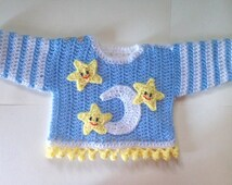 Moon and Stars baby sweater. Crochet baby jacket in white, blue, and yellow. Perfect as a baby shower gift or new baby gift. Handmade