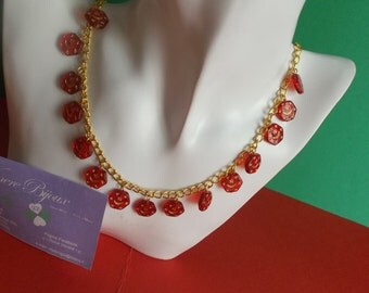 Golden necklace with red glass beads