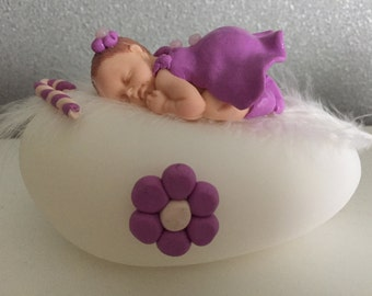 Polymer (clay Fimo) sleeping a little girl a bright Pebble