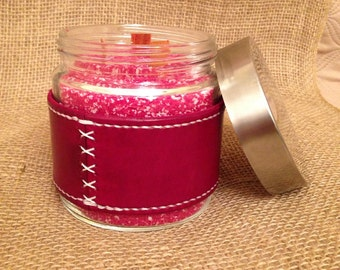 Wood wick candles with leather wrap.