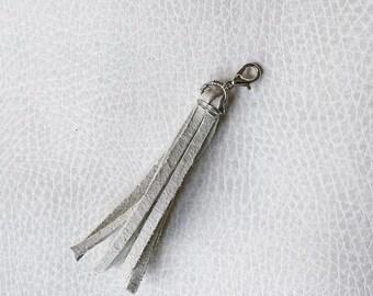 White Suede Tassel // White Leather Zipper Pull