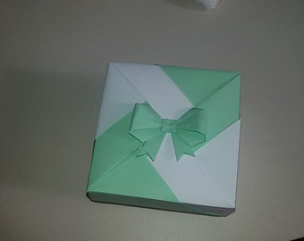 origami box with colored ribbon