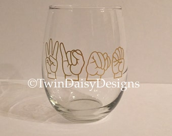 "Stemless ""wine"" glass in sign language (ASL)"
