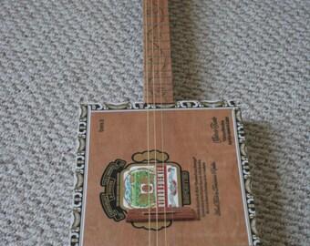 Four String Acoustic Cigar Box Guitar - Arturo Fuente