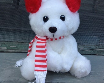 This is a vintage Russ Berrie Buster Plush Teddy Bear White & Red Scarf Winter Earmuff 1521