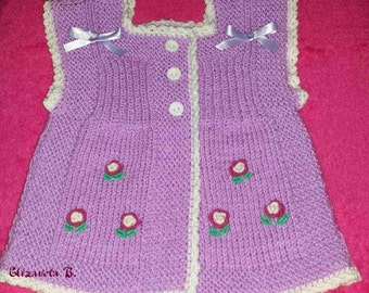 Hand knitted vest with flowers for 18 to 24-month baby girl.