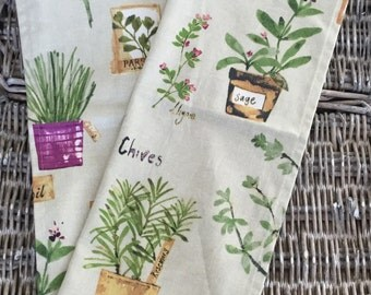 Cotton tea towel in herb print fabric with rosemary, chives, parsley, basil