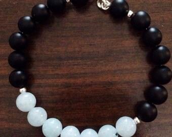 Aquamarine, black onyx, and sterling silver bracelet