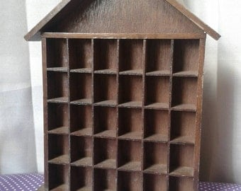 Wooden Thimble home, storage.