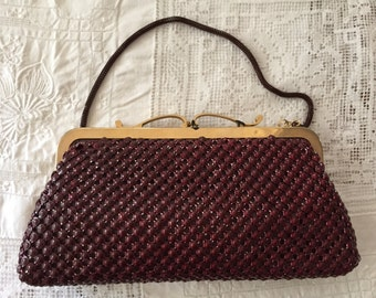 Burgundy clutch handbag