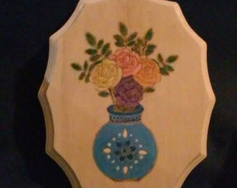 Pyrography wood burned plaque with roses in a blue vase