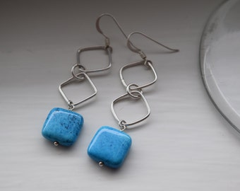 Sterling silver dangle earring with blue bead