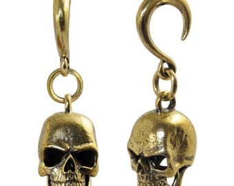 Pair of brass pendants depicting Weights and human skulls, finished and polished by hand, crafts
