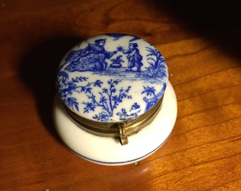A white and blue porcelain box