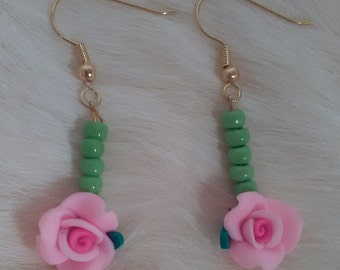 Upside down green beaded rose