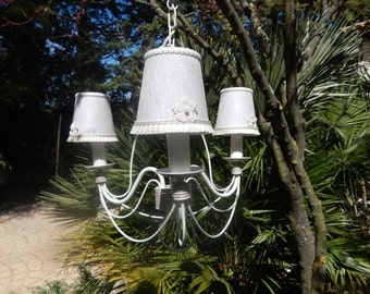 vintage chandelier with three lamps and  linnen shades