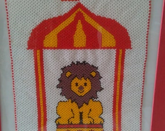Explanations for a tapestry small circus lion