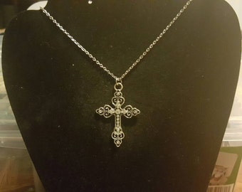 Silver colored cross necklace
